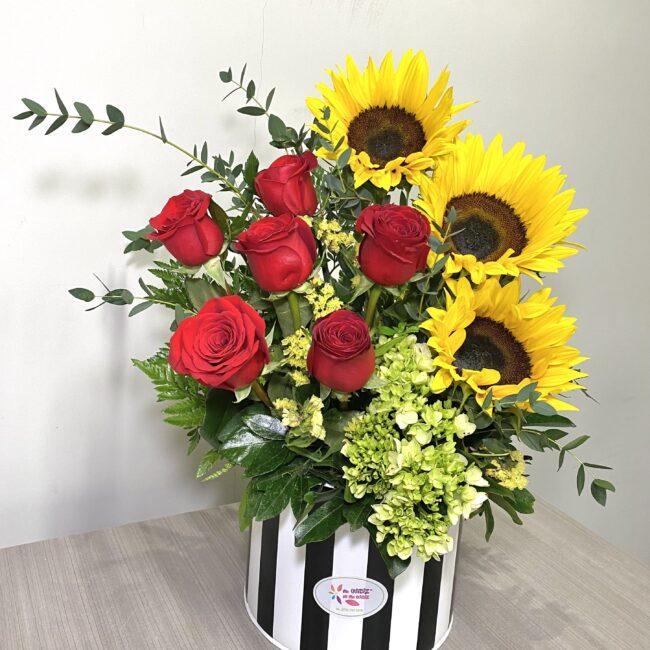 6 rosas y girasol